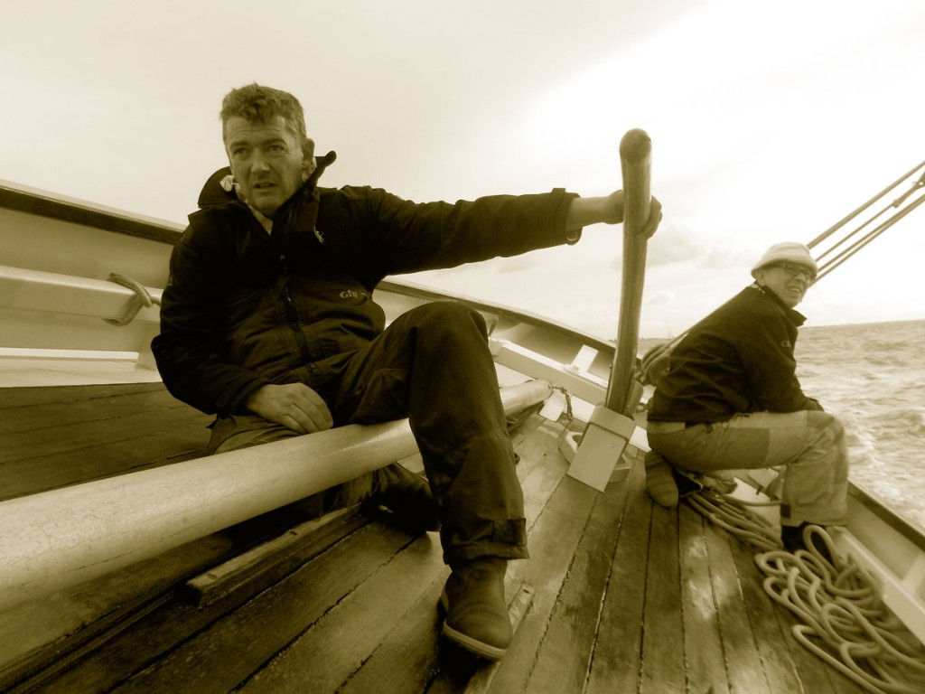 Paul on the helm with Crispin by the mainsheet during Mersea Regatta